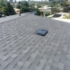 Photo by Elite Roof Services. OC Onyx Black Duration Shingles - thumbnail