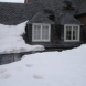 Photo by Fick Bros. Roofing & Exterior Remodeling Company. Burnett - Gutters, Snow Guards & EPDM Roof - thumbnail