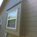 Photo by Integrity Roofing, Siding, Gutters & Windows. Complete James Hardie Color Plus system in Lees Summit, MO - thumbnail