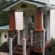 Photo by All American Exteriors. Timbertech Decking, Rails, Stone & Cedar Columns - thumbnail
