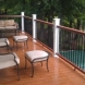 Photo by All American Exteriors. Timbertech Decking, Rails, Stone & Cedar Columns - thumbnail