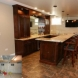 Photo by Gallery Design & Remodeling. Basement with Custom Bar - Downers Grove - thumbnail