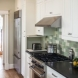 Photo by Wentworth, Inc.. 1930s rowhouse kitchen and basement remodel - thumbnail