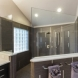 Photo by Curb Appeal Renovations. Contemporary Master Bath - thumbnail