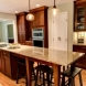 Photo by Wood Wise Design & Remodeling Inc.. kitchen & laundry room - thumbnail