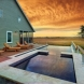 Photo by Renaissance South Construction Company. Sullivan's Island Outdoor Kitchen and Spa/Picture Window - thumbnail