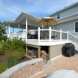 Photo by Breyer Construction & Landscape, LLC. Azek Deck with Roof - thumbnail