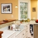 Photo by Tabor Design Build. Stone Green Kitchen - thumbnail