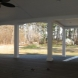 Photo by Kingsford Siding, Windows & Patio Rooms. Patio Cover w/ stamp stain concrete and composite decking  - thumbnail