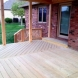 Photo by Gettum Associates, Inc. Greenwood Covered Porch - thumbnail
