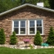 Photo by Craftsman's Choice. Siding and stone - thumbnail
