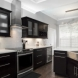 Photo by Robinson Renovation & Custom Homes, Inc.. Fireplace and Kitchen  - thumbnail
