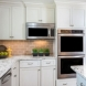 Photo by Wentworth, Inc.. Traditional kitchen with subtle rustic charm - thumbnail
