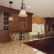 Photo by Legacy Builders Group. Kitchen, Great room and outdoor living space - thumbnail