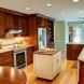 Photo by Wood Wise Design & Remodeling Inc.. Kitchen & Half Bath - thumbnail