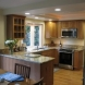 Photo by The Kitchen Crafter. Compact kitchen, bay window - thumbnail