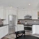 Photo by Bellweather Construction. Cherry Hill, New Jersey: Open Office Kitchen with Diagonal Fridge and Rustic Floors - thumbnail