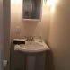 Photo by Acclaim Renovations & Design. Bathroom in Basement Remodel - thumbnail