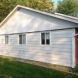 Photo by Moss Roofing. Insulated Siding Before and After - thumbnail