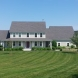 Photo by Care Free Homes Inc.. Custom Built Colonial with Farmer's Porch in South Dartmouth, MA - thumbnail