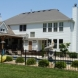 Photo by STL Siding Pros. Arctic White James Hardie Siding - thumbnail