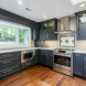 Photo by Synergy Builders. Whole House Remodel - thumbnail