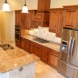 Photo by Marco Island Floor & Remodeling. Traditional kitchen with beverage center - thumbnail