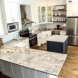 Photo by Marco Island Floor & Remodeling. Traditional Coastal Kitchen with Island - thumbnail